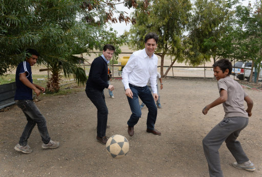 Labour leader Ed Miliband and Shadow Foreign Secretary Douglas Alexander (2nd left) play football during a visit to the Khan al-Ahmar Bedouin community in the West Bank.